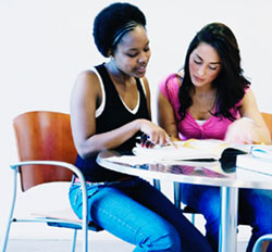Two female college students studying together
